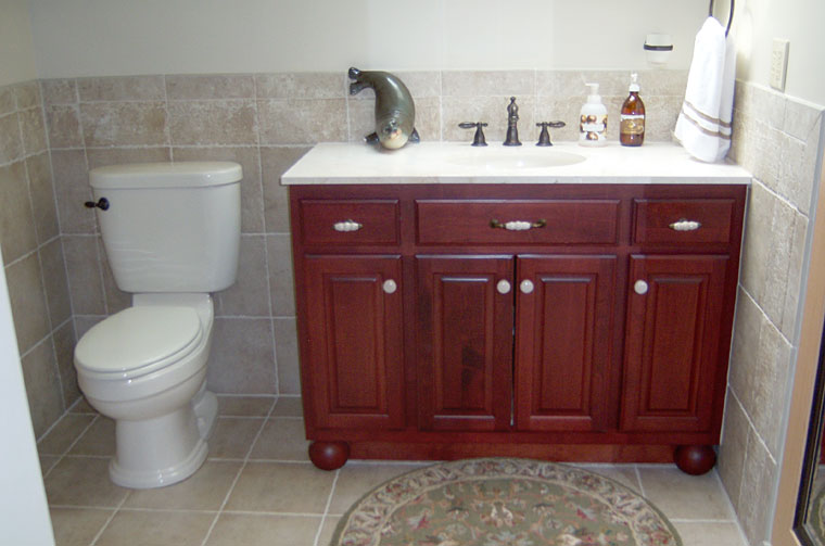 Bathroom with tile floor and wall