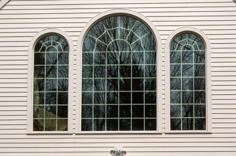 Close up view of living room windows from outside