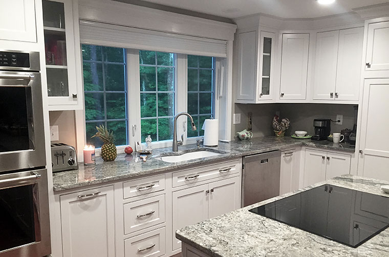 White kitchen sink and cabinets