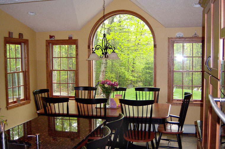 Dining room with large window looking into back yard