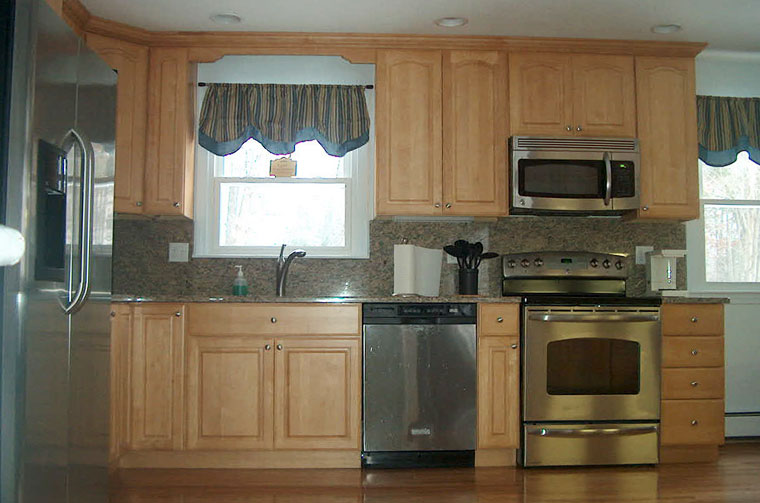 Kitchen with light cabinets, granite counter-tops and stainless steel appliances 2
