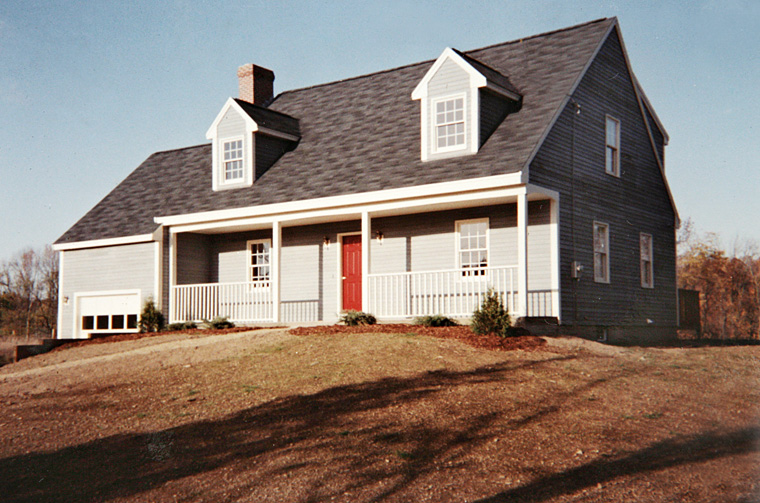 Cape style house with red front door