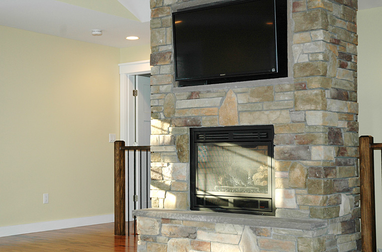 Stone fireplace with mounted television